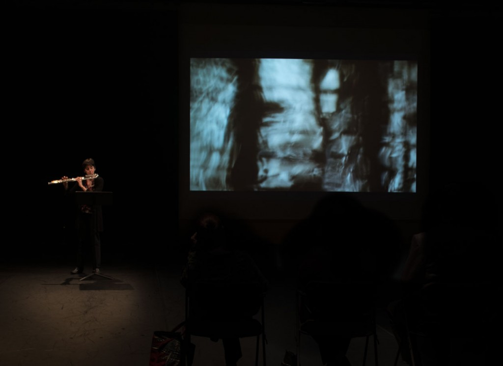 Lisa Cella, bass flute, in peerformance with Stephen Bradley's video projection